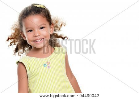 Portrait of a cute small hispanic girl isolated on white