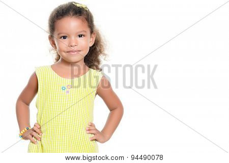 Portrait of a pretty small african-american or hispanic girl smiling isolated on white