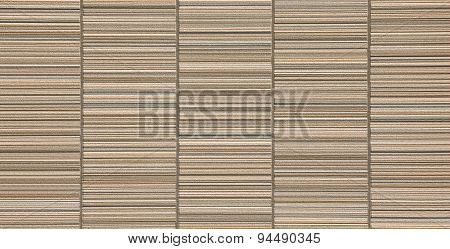 The modern brown concrete tile wall background and texture .