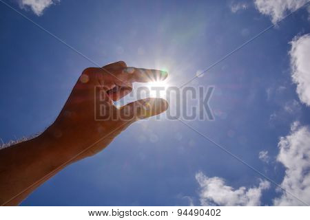Hand over the Sky and Sun