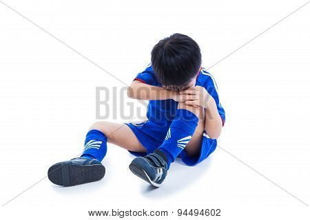 Youth Asian Soccer Player Crying For A Painful Knee Injury. Full Body.