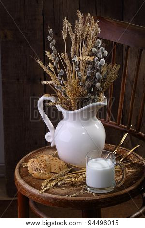Still-life With Milk, Fresh Bread And A Bouquet From Cones And A Willow