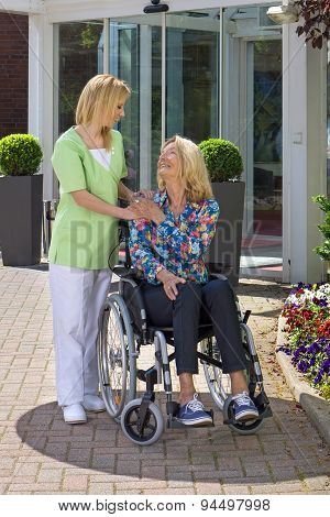 Nurse Showing Care For Senior Woman In Wheelchair