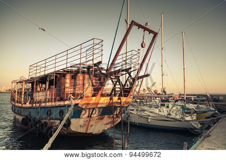 Old Rusted Pleasure Boat Is Moored In Nesebar
