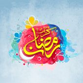 stock photo of crescent  - Shiny Arabic Islamic calligraphy of text Eid Mubarak with white crescent moon on colorful splash and flowers decorated grungy background for Muslim community festival celebration - JPG
