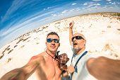 foto of mans-best-friend  - Hipster best friends taking a selfie at Etosha national park in Namibia  - JPG
