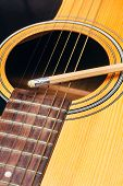 stock photo of risque  - Close up pencil on guitar  - JPG