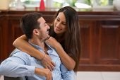 image of flirt  - Happy couple in love hugging and flirting at home - JPG