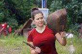 stock photo of welding  - Girl in red with a welding machine in a farmer - JPG