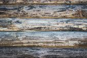 picture of log fence  - Wooden logs wall of rural house background - JPG