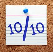 picture of ten  - A perfect score or grade of ten out of ten in blue text on an index card pinned to a cork notice board - JPG