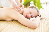 foto of day care center  - Attractive young woman getting massage on her back at spa center - JPG