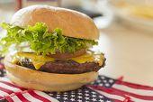 picture of patriot  - Patriotic American flag cheeseburger for American patriotism celebration food image - JPG