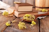 stock photo of roughage  - Old books with dry flowers and lemon on table close up - JPG