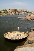 picture of karnataka  - Traditional round boat in river hampi karnataka india - JPG