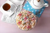 stock photo of cake stand  - Butter cake with cherries on stand and table setting - JPG