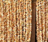 foto of beach shell art  - Colourful shell curtains at the market in Ngapali beach Myanmar - JPG