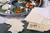 image of matzah  - Matzo for Passover with Seder meal on plate on table close up - JPG