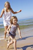 picture of chase  - Mother Chasing Daughter Along Beach - JPG