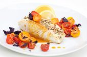 image of halibut  - Pan fried halibut garnished with fennel seeds and spicy mustard sauce served with fried cherry tomatoes salad with purple basil - JPG