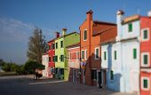 picture of tree lined street  - Tilt shift photo in street of Burano island - JPG