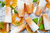 stock photo of popsicle  - Homemade frozen yogurt cantaloupe popsicles - JPG