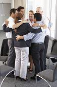 image of bonding  - Group Of Businesspeople Bonding In Circle At Company Seminar - JPG