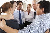 foto of bonding  - Group Of Businesspeople Bonding In Circle At Company Seminar - JPG