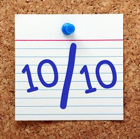 pic of tens  - A perfect score or grade of ten out of ten in blue text on an index card pinned to a cork notice board - JPG