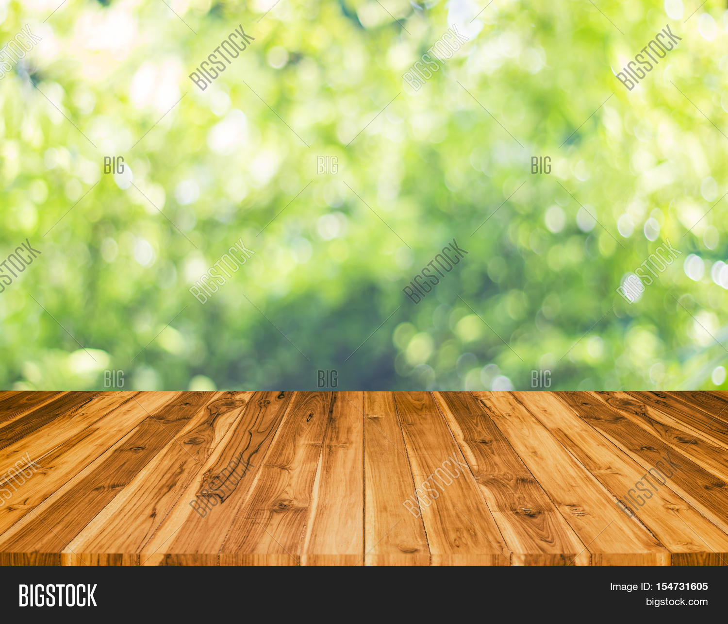 Table With Blur Tree Background. Abstract Blur Background Wood Table ...