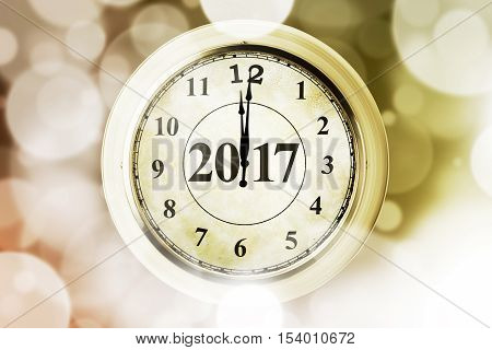 Image of old gold clock and numbers 2017 with glitter background new year midnight concept