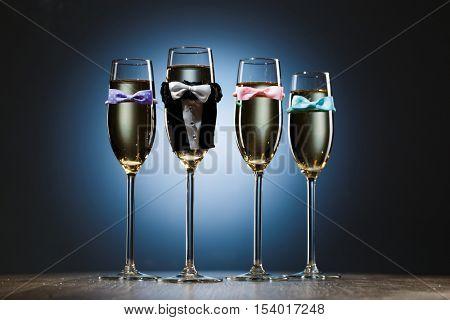 Four elegant stylish champagne glasses. Bachelor party concept