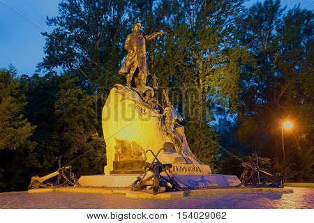 SAINT PETERSBURG, RUSSIA - JULY 04, 2016: Monument to the russian naval commander and polar researcher - to the admiral S. O. Makarov on July night. Historical landmark of the Kronstadt