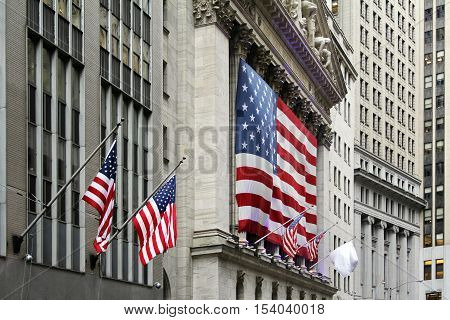 Wall Street with New York Stock Exchange in Manhattan Finance district during United States economy recovery in Manhattan. New York City.