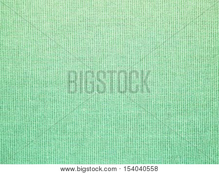 Close up green fabric textured background for scrap booking