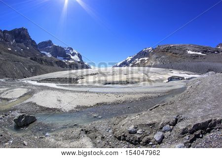 Athabasca Glacier melting in a hot summer day. Columbia Icefields, Jasper National Park, Alberta, Canada