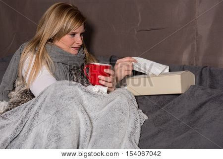 Attractive woman with cold takes a handkerchief