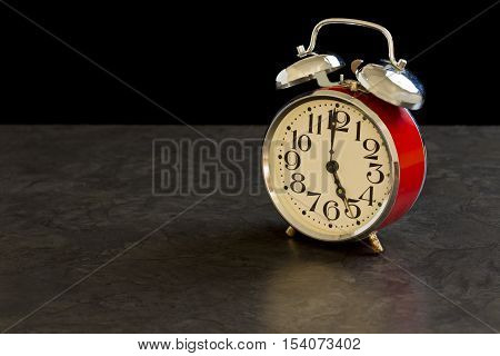 old fashioned alarm clock shows 5am which means its time to get out of bed to start your day