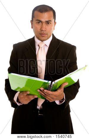 Business-Mann mit einem Buch auf weiß