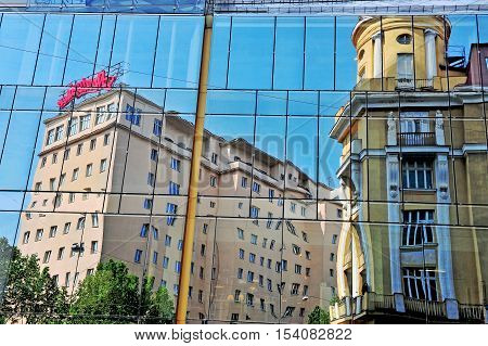 VIENNA AUSTRIA - JUNE 6: Reflection of downtown buildings in Vienna city on June 6 2016. Vienna is a capital and largest city of Austria.