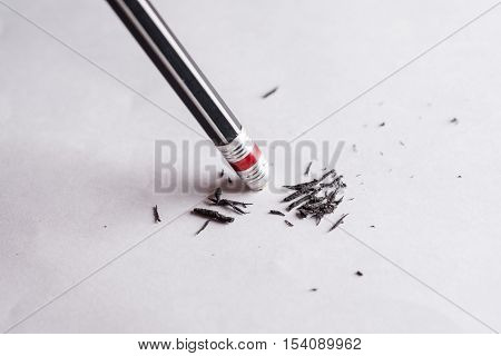 Eraser and error concept Change concept Black pencil with black eraser on white background Mistake erase concept