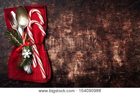 Christmas table place setting with christmas ornaments on wooden table with empty copyspace