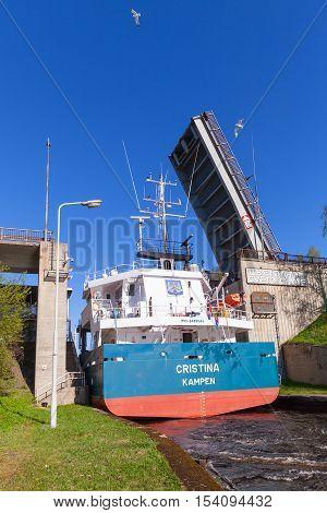 Big Cargo Ship Goes Under Open Bridge
