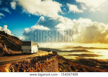 Tourist white bus on mountain road. Ring of Kerry Ireland. Travel destination