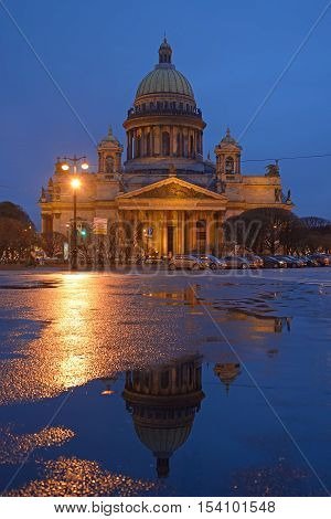 St. Isaac's Cathedral And Its Reflection At Night After Rain