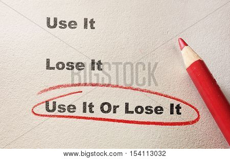 Red circle and pencil with Use It Or Lose It text -- exercise concept