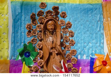 XALAPA, VERACRUZ, MEXICO- OCTOBER 28, 2016: Virgin made of clay. Part of a mexican Day of the dead offering altar