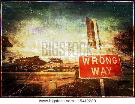 Wrong Way Vintage Grunge Sign And Background