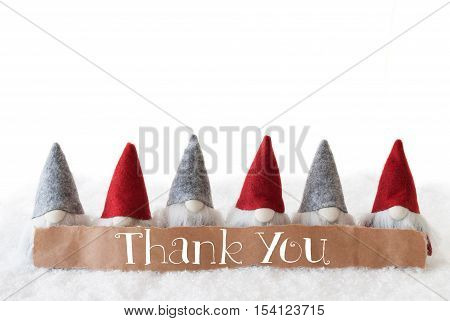 Label With English Text Thank You. Christmas Greeting Card With Gnomes. Isolated White Background With Snow.