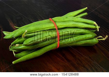 Very close image of fresh pea in pod